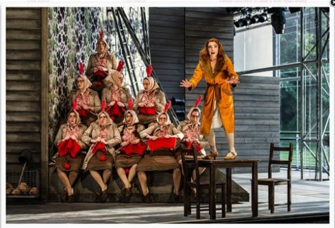 Claire Booth (Vixen) and the  Garsington Opera and Chorus Photo: Clive Barda