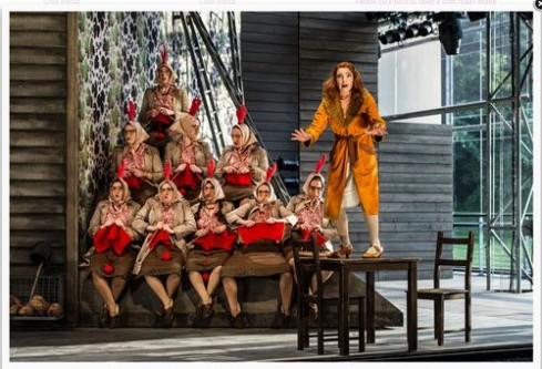 Claire Booth (Vixen) and the  Garsington Opera and Chorus Photo: Clive Barda