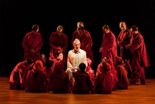The Narrator (Omar Ebrahim) surrounded by chorus. Photo: Mats Bäcker