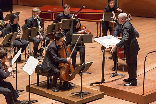 Cellist Jay Campbell, conductor Jeffrey Milarsky, and AXIOM in Ligeti's Cello Concerto. (Photo: Richard Termine)