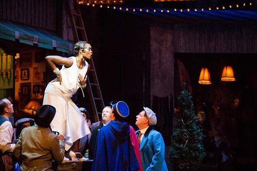Jeanine De Bique (Musetta) and the chorus of La bohème. Scottish Opera 2017. Credit Sally Jubb