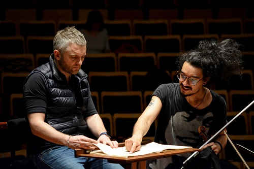 Kirill Karabits (left) with Nemanja Radulović, the soloist in the Tchaikovsky Violin Concerto, in rehearsal